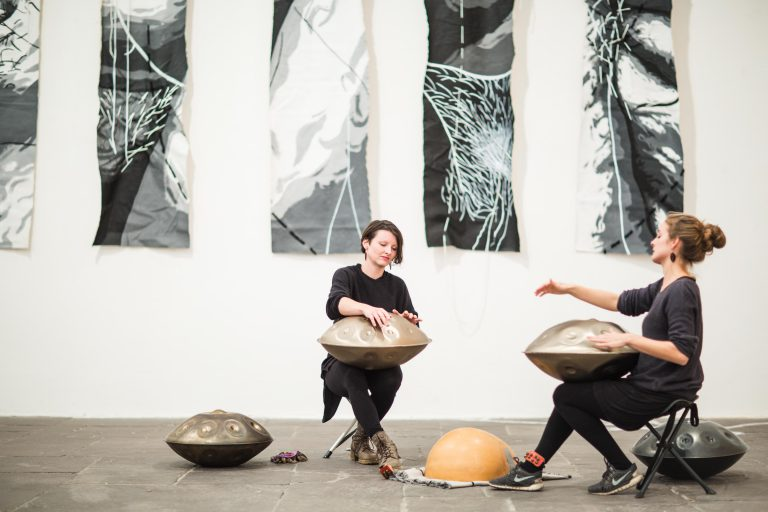 MEA playing handpans in art gallery